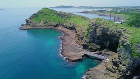 Aerial view of Yongmeori coastal walk on Jeju Island, South Korea. Rough Geological Formation Made with Erosion. Shot with a DJI Mavic fps29,97 4k stock video