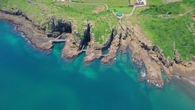 Aerial View of Yongmeori Coastal Walk on Jeju Island, South Korea. Rough Geological Formation Made with Erosion. Shot with a DJI Mavic fps29,97 4k stock footage