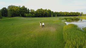Aerial View Of Young Couple Walking In Summer Park, Circling Drone Shooting Man And Woman. Outdoors stock footage