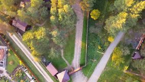 Aerial view of young man traveling and walking on the forest walkway trail - travel and recreation concept. Aerial view. Of man walks in Park stock video