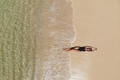Aerial view of young woman on beach stock photos