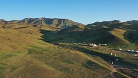 Aerial view of yurts between montains Mongolia. Aerial view of traditional yurts between montains at sunset, Mongolia, 4k stock video