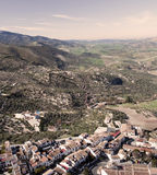 Aerial view of Zahara. A massive landscape surrounded by trees, in the village of Zahara de la sierra in Spain. You can see some white house and roof in the Royalty Free Stock Images