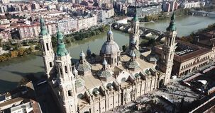 Aerial view of Zaragoza with Cathedral-Basilica of Our Lady of Pillar on bank of Ebro river, Spain