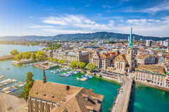 Aerial view of Zurich with river Limmat, Switzerland. Aerial view of Zurich city center with famous Fraumunster Church and river Limmat at Lake Zurich from Royalty Free Stock Images