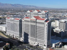 Aerial views of Caesars Palace. Looking from the air at the beautiful Caesars Palace and the view all the way to the mountains royalty free stock photos