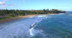 Aerial Views of Kauai Island in Hawaii. Amazing aerial view of the Hawaii nature, beac, Pacific ocean waves during sunset time. View on the beach at the Kauai stock video