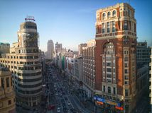 Aerial views of the street Gran Via in Madrid at sunset. Stock Images
