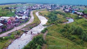 Aerial views of village Tyulyuk near of mount Iremel in the Southern Urals. Summer stock footage
