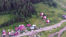 Aerial views of village Tyulyuk near of mount Iremel in the Southern Urals stock video footage