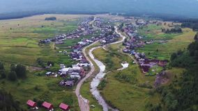 Aerial views of village Tyulyuk near of mount Iremel in the Southern Urals stock video