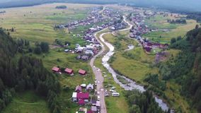 Aerial views of village Tyulyuk near of mount Iremel in the Southern Urals stock footage