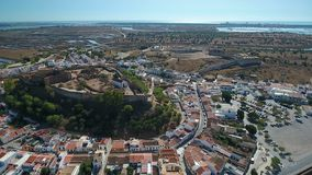 Aerial. The village of Castro Marim and the castle, filmed from sky drone. Aerial. The village of Castro Marim and the castle, filmed from the sky drone stock footage