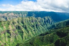 Aerial voew of the typical abrupt mountain ranges in Kauai, US. Kauai is Hawaii`s fourth largest island and is sometimes called the Garden Island, which is an royalty free stock images
