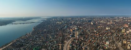 Aerial Voronezh city panorama from above with buildings, river with bridges, rads and car traffic, drone photo stock photos