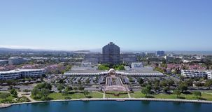 Aerial water front view of metro center tower in foster city. Near Visa Global HQ on hills dale blvd drone fly forward stock video footage