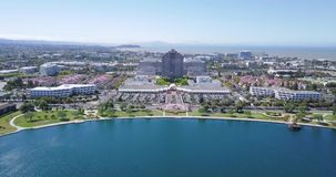 Aerial water front view of metro center tower in foster city. Near Visa Global HQ on hills dale blvd hovering drone stock footage