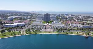 Aerial water front view of metro center tower in foster city. Near Visa Global HQ on hills dale blvd drone fly backward stock footage