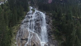 Aerial of waterfall in the mountains stock video