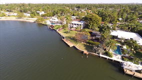Aerial waterfront real estate stock footage