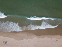 Aerial of Waves and Beach on Cape Cod, MA. Waves from the Atlantic Ocean wash onto a scenic beach on Cape Cod, Massachusetts. This sandy peninsula is a popular Royalty Free Stock Photography