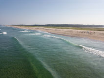 Aerial of Waves and Beautiful Beach on Cape Cod, MA. Waves from the Atlantic Ocean wash onto a scenic beach on Cape Cod, Massachusetts. This sandy peninsula is a Stock Images