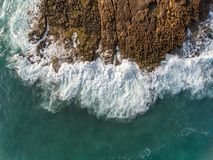 Aerial. Waves break on the rocks from the sky. Portugal Royalty Free Stock Photo