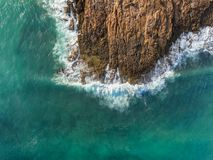 Aerial. Waves break on the rocks from the sky. Portugal stock photography
