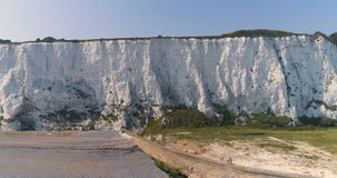 Aerial. White cliffs panorama of Dover from sea. England, East Sussex. Between France and UK. 4k. Aerial. White cliffs of Dover from sea. England, East Sussex stock video footage