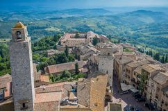 Aerial wide-angle view of the historic town of San Gimignano with Tuscan countryside, Tuscany, Italy stock photo