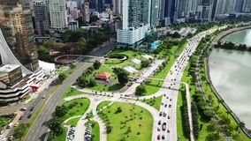 Aerial wide shot of Panama City traffic in the downtown of the city, shore. Aerial view of morning traffic on Balboa avenue in Panama City skyscrapers skyline stock footage
