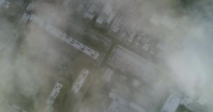 Aerial wiev: Amazing Flying over the Clouds of Fog, above the City stock footage