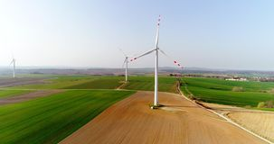 Aerial wiev of windmills farm. Power Energy Production. Windmill and Wind power technology background. Aerial view on Wind Power, Turbine, Windmill, Energy stock footage