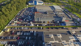 Aerial wiew of car dealer center stock footage