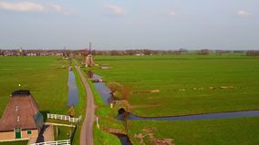 Aerial from windmills at Kinderdijk in the Netherlands stock video footage