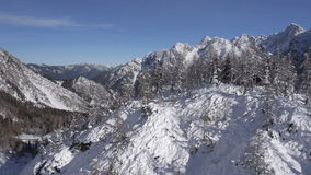 AERIAL: Winter fairytale in mountains stock video footage