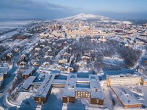 Aerial winter view of Kiruna, the northernmost town in Sweden, province of Lapland, winter sunny picture shot from drone. Aerial winter view of Kiruna, the Stock Photos