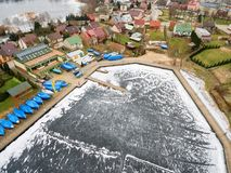 Aerial winter view of Yacht Club Arcus in Rajgrod. Aerial view of Yacht Club Arcus in Rajgrod, Poland royalty free stock images