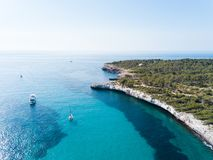 Aerial: Seashore of Mallorca in summer. Aerial: Yachts in the bay of Mallorca in summer Royalty Free Stock Images