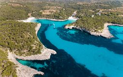Aerial: The beach of Cala Mondrago in Mallorca, Spain. Aerial: Yachts in the bay of Mallorca in summer Royalty Free Stock Photography
