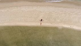 Aerial: Young Beautiful Smiling Woman in Bikini Laying on Beach. Caucasian Female Model Posing on the Beach. Koh stock video footage