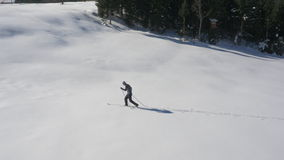 Aerial - Young man ski running stock video