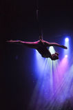 Aerialist in circus Stock Images