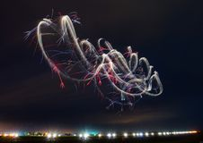 Aeriel Ballet In The Night Sky!. Gene Soucy flying his night aerobatic routine at AirVenture Oshkosh! Keeping the shutter open an extended period of time Stock Photography