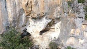 Aeriel view of Adamkayalar Roma Reliefs. On the rocks in Mersin, Turkey stock video