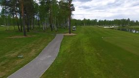 Aeriel view on Golf cart on golf course in the afternoon with copy space. Elite golf club. stock video footage