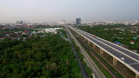 Aeriel view train express way local road. West urban Bangkok Thailand May 22:Aerial view train and Tollway from edge of Bangkok to west urban on May22, 2017 stock video
