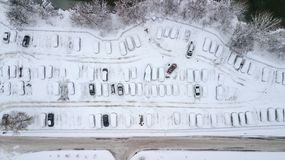 Aerila view of snow-covered cars stand in the parking lot on a winter day Stock Images