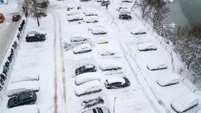 Aerila view of snow-covered cars stand in the parking lot on a winter day Royalty Free Stock Image