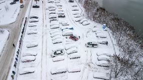 Aerila view of snow-covered cars stand in the parking lot on a winter day Stock Photography